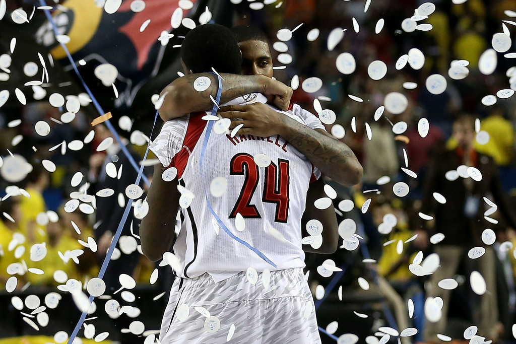 . (L-R) Montrezl Harrell #24 and Chane Behanan #21 of the Louisville Cardinals celebrate after they won 82-76 against the Michigan Wolverines during the 2013 NCAA Men\'s Final Four Championship at the Georgia Dome on April 8, 2013 in Atlanta, Georgia.  (Photo by Streeter Lecka/Getty Images)