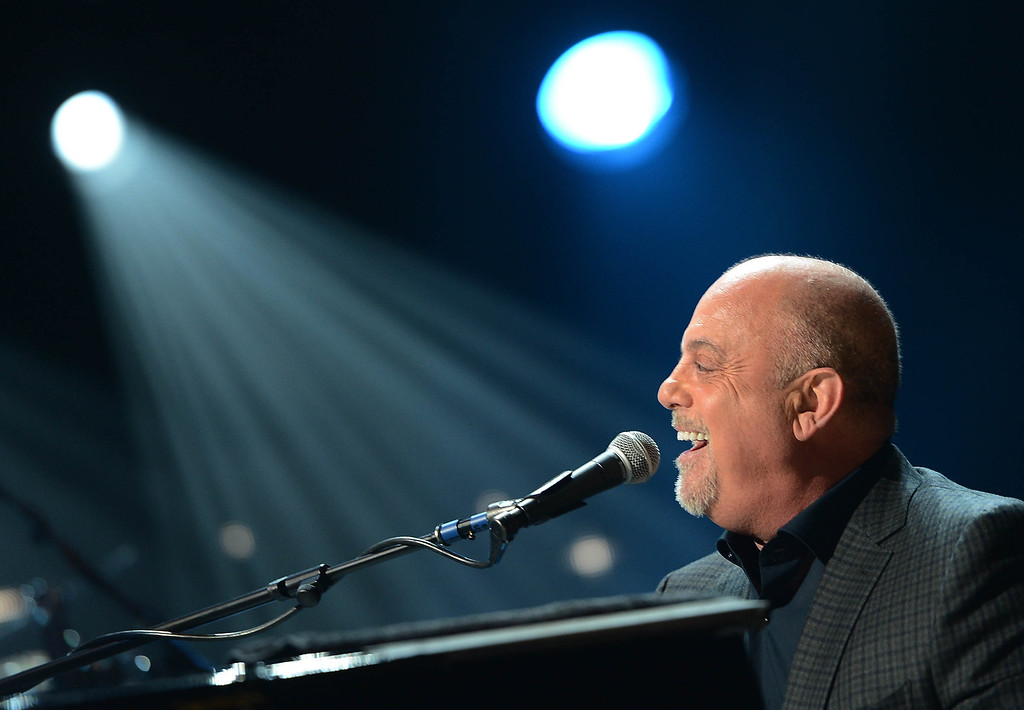 ". Billy Joel performs at ""12-12-12\"" a concert benefiting The Robin Hood Relief Fund to aid the victims of Hurricane Sandy presented by Clear Channel Media & Entertainment, The Madison Square Garden Company and The Weinstein Company at Madison Square Garden on December 12, 2012 in New York City.  (Photo by Larry Busacca/Getty Images for Clear Channel)"