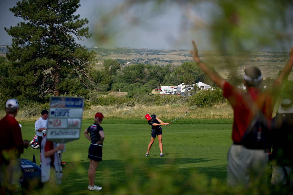 . PARKER, CO - AUGUST 16: A volunteer silences the crowd before American Jessica Korda takes a shot on the eighth hole during the first day of the Solheim Cup at Colorado Golf Club, on August 16, 2013.  (Photo By Grant Hindsley/The Denver Post)