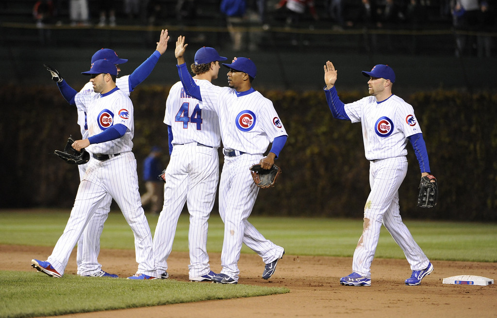 . The Chicago Cubs celebrate their win against the Colorado Rockies  on May 13, 2013 at Wrigley Field in Chicago, Illinois. The Chicago Cubs defeated the Colorado Rockies 9-1.  (Photo by David Banks/Getty Images)