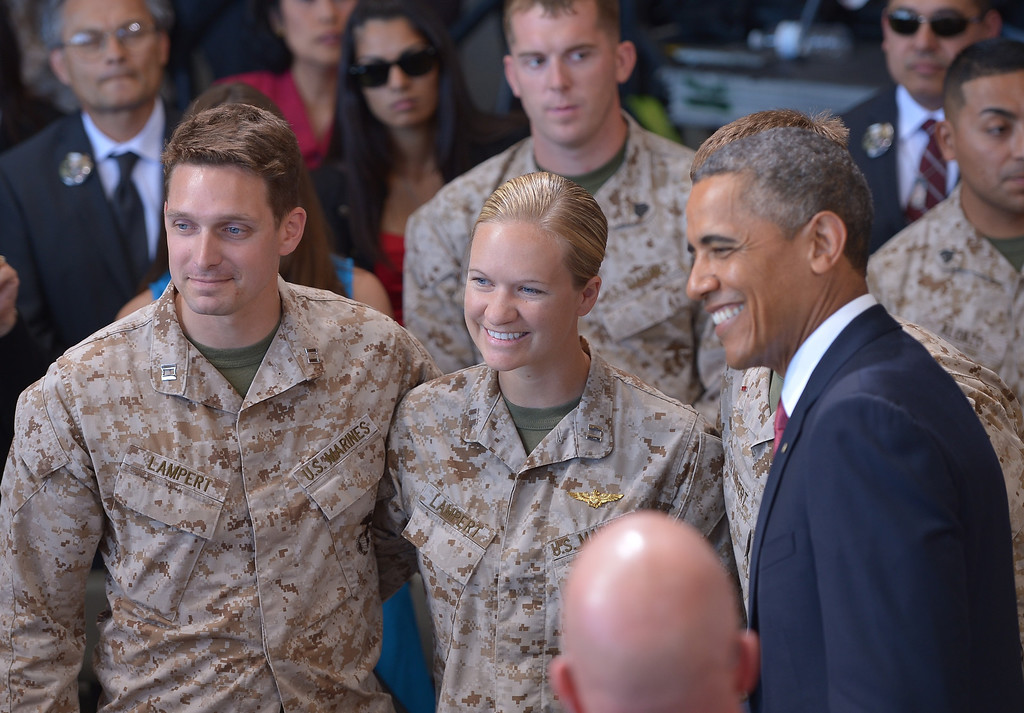 . US President Barack Obama poses with Captain Matthew Lampert and his wife Camille Lampert after speaking at Camp Pendleton in California on August 7, 2013. Matthew, who was wounded and lost both his legs, return to serve in his unit. MANDEL NGAN/AFP/Getty Images