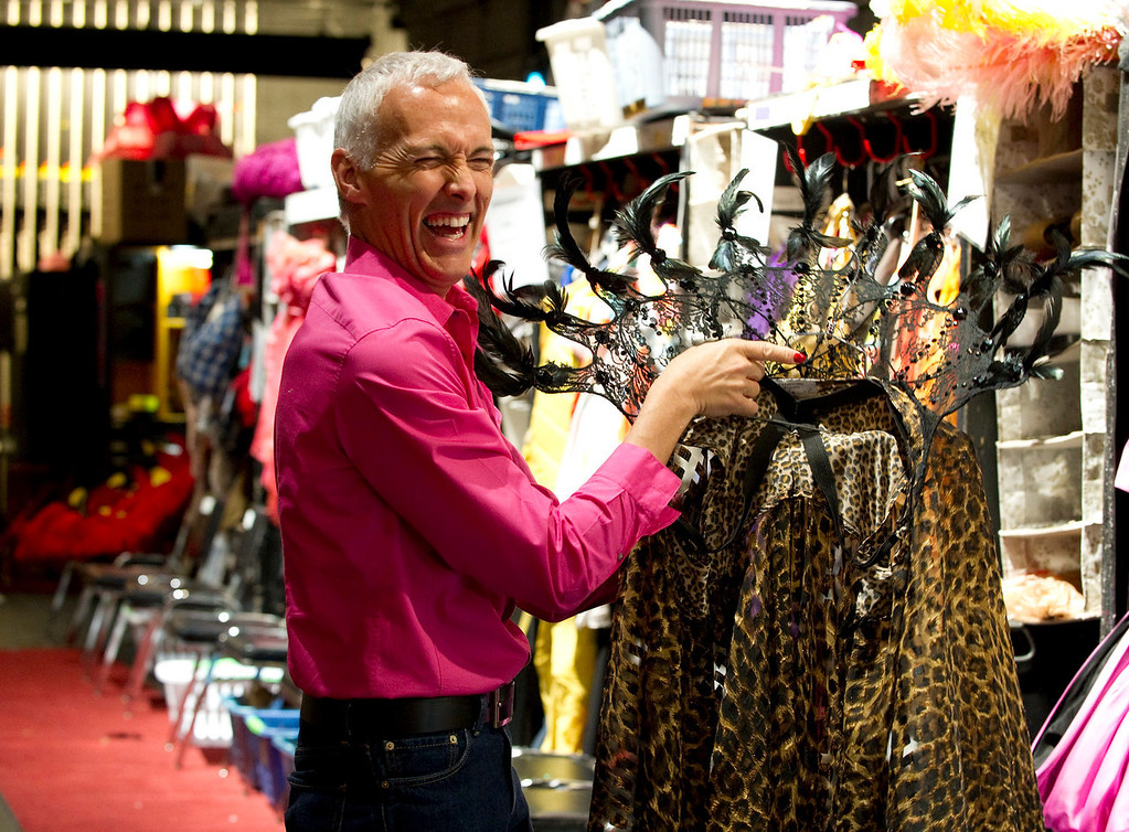 """. Actor Scott Willis, who plays \""""Bernadette\"""" holds one of the many costumes  backstage at the Buell Theatre for the colorful production of \""""Priscilla Queen of the Desert The Musical\"""" on Thursday September 5, 2013. There are over 500 Tony Award winning costumes.   (Photo By Cyrus McCrimmon/The Denver Post )"""
