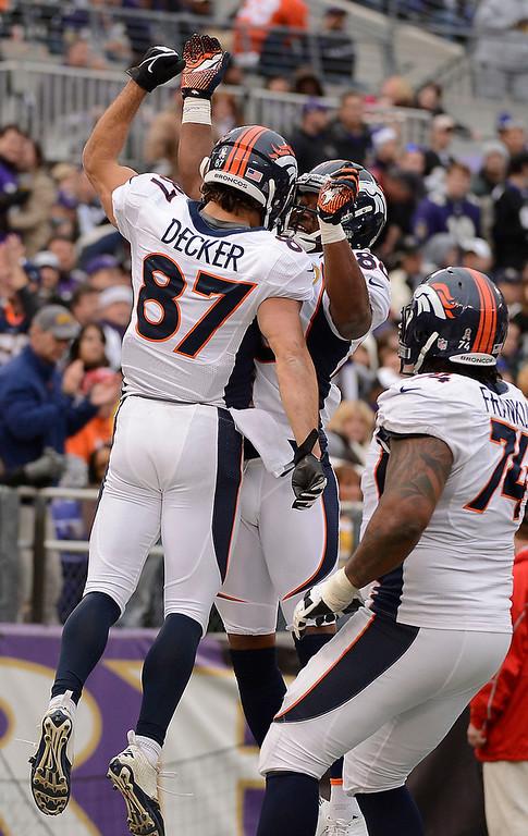 . Denver Broncos wide receiver Eric Decker (87) celebrates his 51-yard touchdown catch with Denver Broncos wide receiver Demaryius Thomas (88) during the third quarter Sunday, December 16, 2012 at M&T Bank Stadium.  John Leyba, The Denver Post