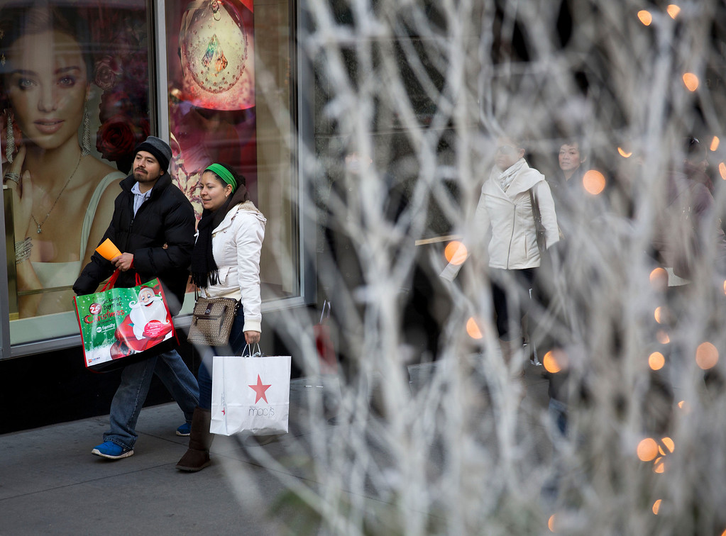 . Shoppers walk down Michigan Ave.  on Friday, Nov. 29, 2013, in Chicago. Black Friday, the day after Thanksgiving, is typically the nation\'s biggest shopping day of the year. (AP Photo/Andrew A. Nelles)