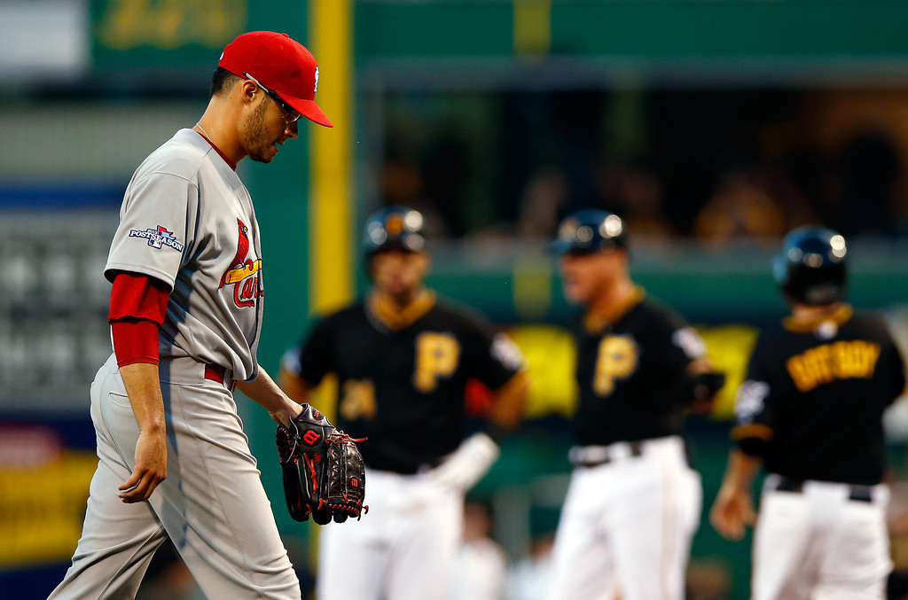. Joe Kelly #58 of the St. Louis Cardinals walks off the mound after being pulled in the sixth inning against the Pittsburgh Pirates during Game Three of the National League Division Series at PNC Park on October 6, 2013 in Pittsburgh, Pennsylvania.  (Photo by Jared Wickerham/Getty Images)