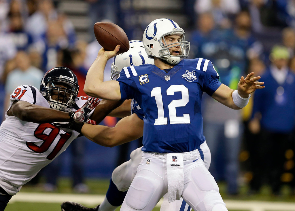 . Indianapolis Colts quarterback Andrew Luck (12) throws under pressure from Houston Texans linebacker Ricky Sapp during the first half of an NFL football game in Indianapolis, Sunday, Dec. 15, 2013. (AP Photo/Darron Cummings)