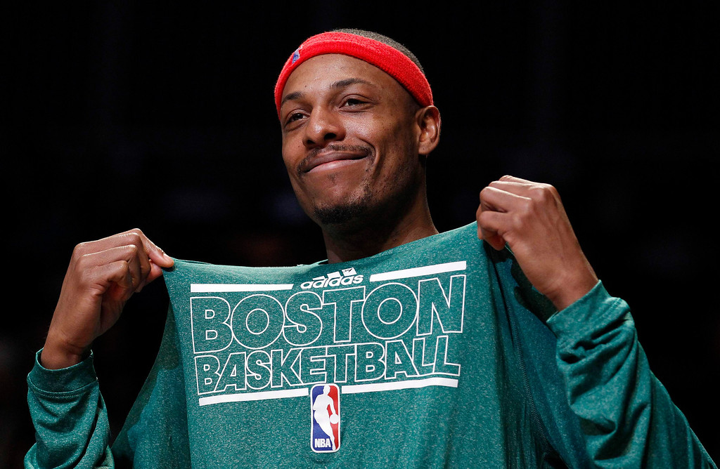 . Boston Celtics small forward Paul Pierce smiles on the bench in the second half of their NBA basketball game against the Brooklyn Nets in New York, December 25, 2012.    REUTERS/Adam Hunger