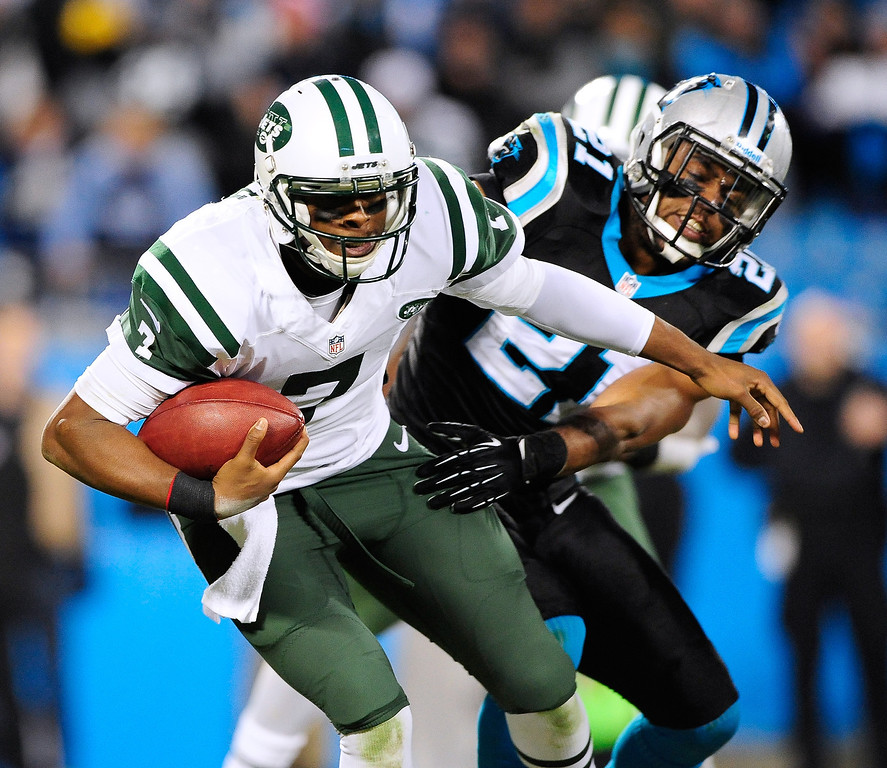 . Mike Mitchell #21 of the Carolina Panthers sacks Geno Smith #7 of the New York Jets during play at Bank of America Stadium on December 15, 2013 in Charlotte, North Carolina. The Panthers won 30-20.  (Photo by Grant Halverson/Getty Images)