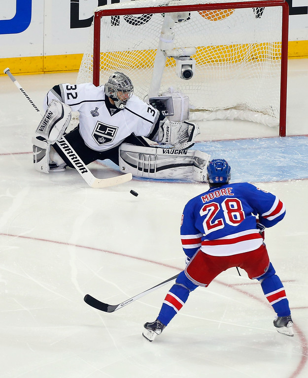. Jonathan Quick #32 of the Los Angeles Kings makes a save on Dominic Moore #28 of the New York Rangers during the second period of Game Four of the 2014 NHL Stanley Cup Final at Madison Square Garden on June 11, 2014 in New York, New York.  (Photo by Jim McIsaac/Getty Images)