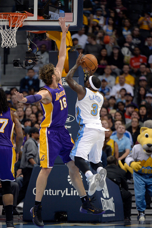 . DENVER, CO - NOVEMBER 13: Denver Nuggets point guard Ty Lawson (3) gets his shot blocked by Los Angeles Lakers center Pau Gasol (16) during the third quarter November 13, 2013 at Pepsi Center. (Photo by John Leyba/The Denver Post)