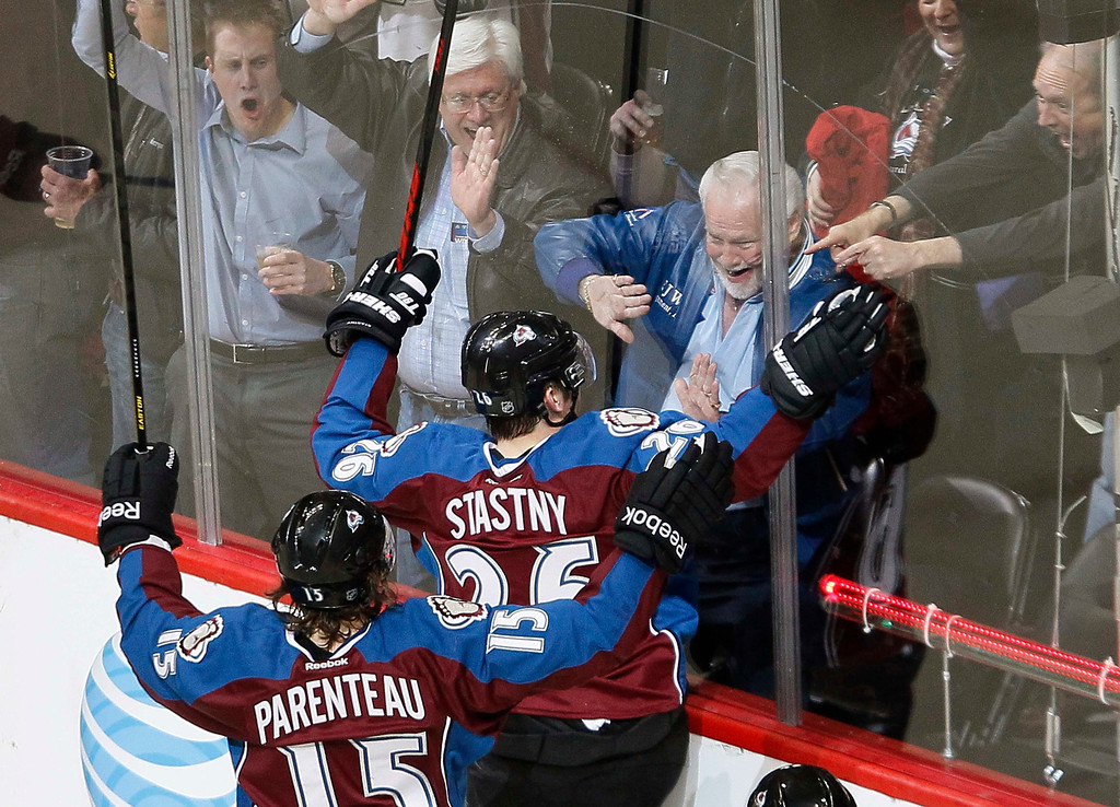 . Colorado Avalanche Paul Stastny (C) celebrates with fans after scoring a first period goal over the Chicago Blackhawks in their NHL hockey game in Denver March 8, 2013. REUTERS/Rick Wilking