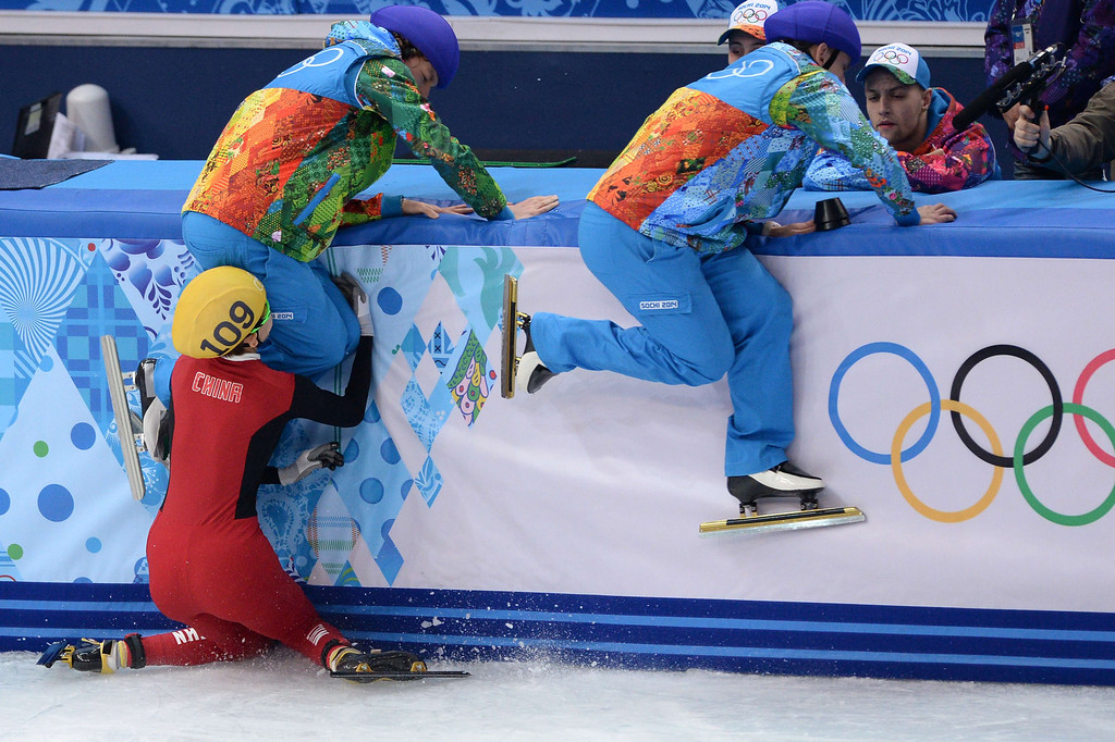 . China\'s Fan Kexin falls as she competes in the Women\'s Short Track 500 m Semifinals at the Iceberg Skating Palace during 2014 the Sochi Winter Olympics on February 13, 2014.  ANDREJ ISAKOVIC/AFP/Getty Images