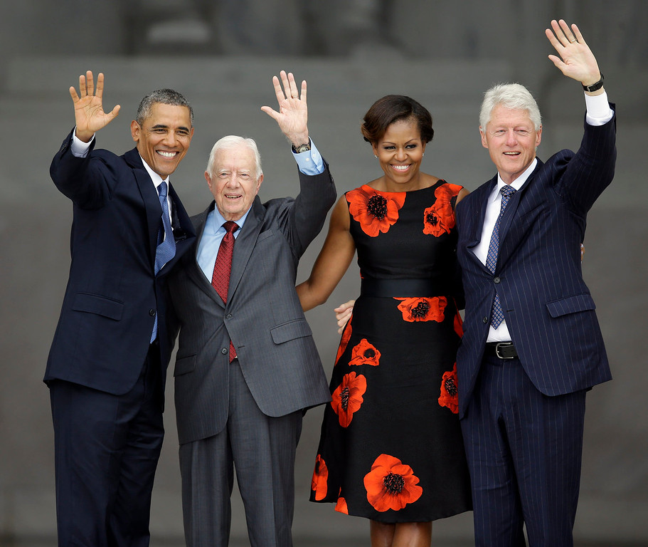 ". President Barack Obama, former President Jimmy Cater, first lady Michelle Obama and former President Bill Clinton wave at the end of  the Let Freedom Ring ceremony at the Lincoln Memorial in Washington, Wednesday, Aug. 28, 2013, to commemorate the 50th anniversary of the 1963 March on Washington for Jobs and Freedom. It was 50 years ago today when Martin Luther King Jr. delivered his ""I Have a Dream\"" speech from the steps of the memorial. (AP Photo/Carolyn Kaster)"