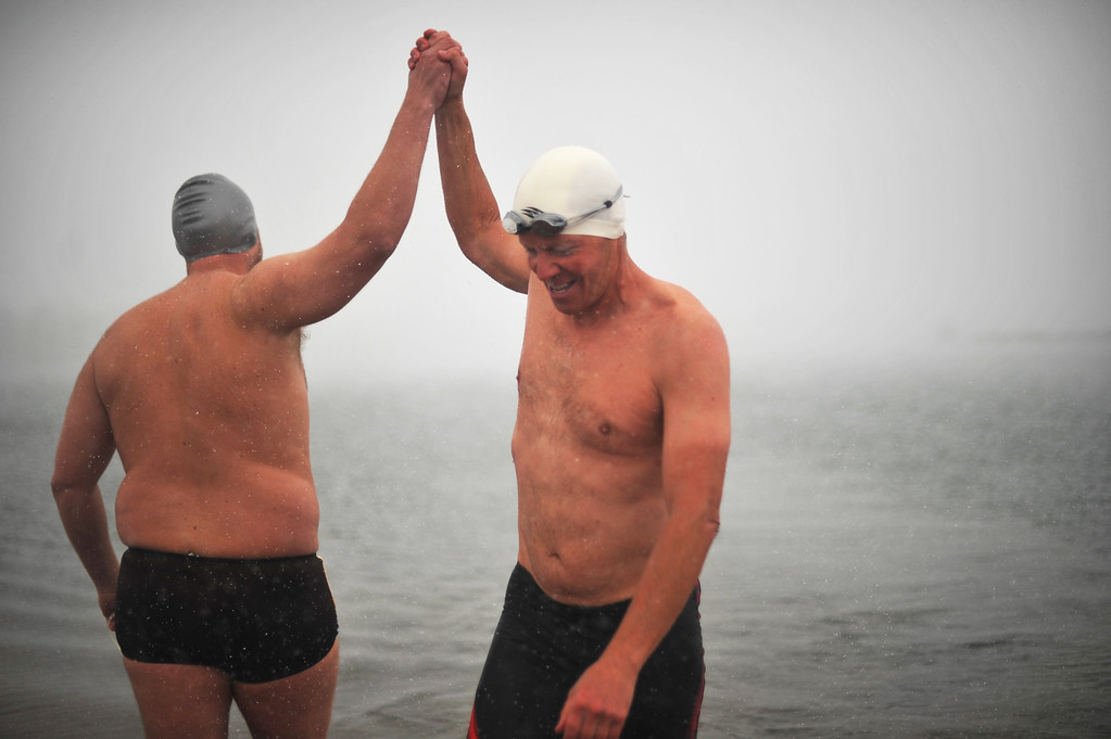 . LITTLETON, CO. - MAY 01 : Jeffrey Hulett of Golden, right, and Craig Lenning of Denver celebrate the opening day of the open water swimming season at Gravel Pond in Chatfield State Park. Littleton, Colorado. May 1, 2013. (Photo By Hyoung Chang/The Denver Post)
