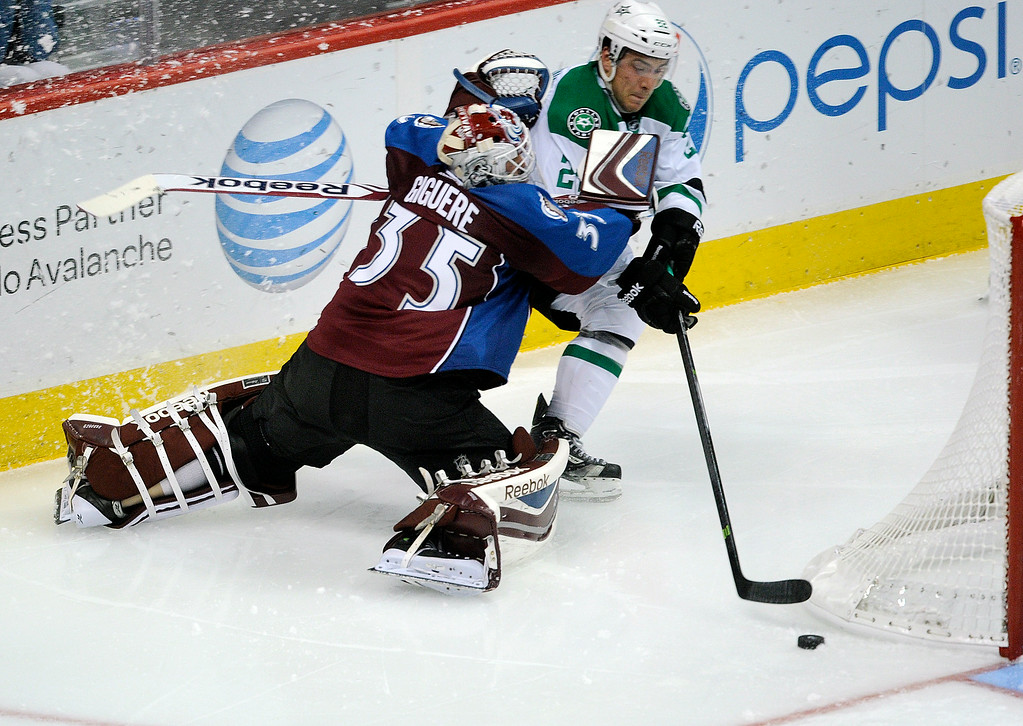 . Colorado goaltender J.S. Giguere (35) tried to slow down Dallas center Colton Sceviour (22) behind his net in the second period. The Colorado Avalanche hosted the Dallas Stars at the Pepsi Center Tuesday night, September 24, 2013. Photo By Karl Gehring/The Denver Post