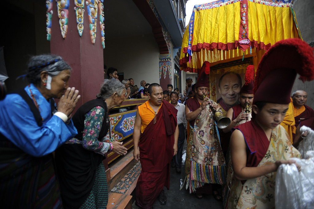 . Tibetans in-exile participate in a procession in honour of their spiritual leader, His Holiness The Dalai Lama, as they observe his 78th birthday at Manag monastry in Kathmandu on July 6, 2013.  Thousands of Tibetans gathered to mark the Dalai Lama\'s 78th birthday on July 6, with the Nepalese government saying it would not tolerate anti-China activities on its soil.  PRAKASH MATHEMA/AFP/Getty Images