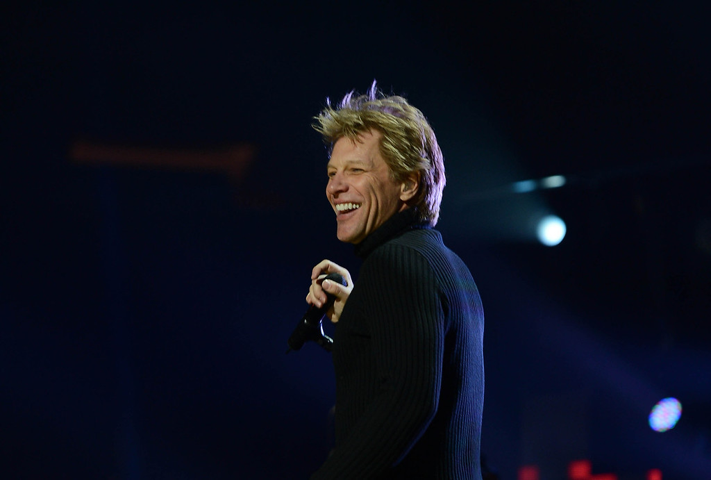 ". NEW YORK, NY - DECEMBER 12:  Musician Jon Bon Jovi performs at ""12-12-12\"" a concert benefiting The Robin Hood Relief Fund to aid the victims of Hurricane Sandy presented by Clear Channel Media & Entertainment, The Madison Square Garden Company and The Weinstein Company at Madison Square Garden on December 12, 2012 in New York City.  (Photo by Larry Busacca/Getty Images for Clear Channel)"