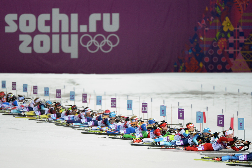 . Athletes compete at the shooting range during the Women\'s 12.5 km Mass Start during day ten of the Sochi 2014 Winter Olympics at Laura Cross-country Ski & Biathlon Center on February 17, 2014 in Sochi, Russia.  (Photo by Harry How/Getty Images)