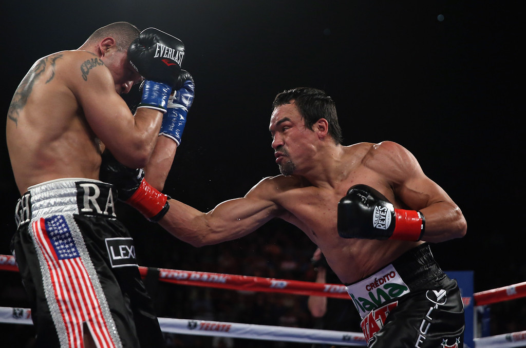 . INGLEWOOD, CA - MAY 17:  Juan Manuel Marquez (R) lands a right hand to the body of Mike Alvarado at The Forum on May 17, 2014 in Inglewood, California.  (Photo by Jeff Gross/Getty Images)