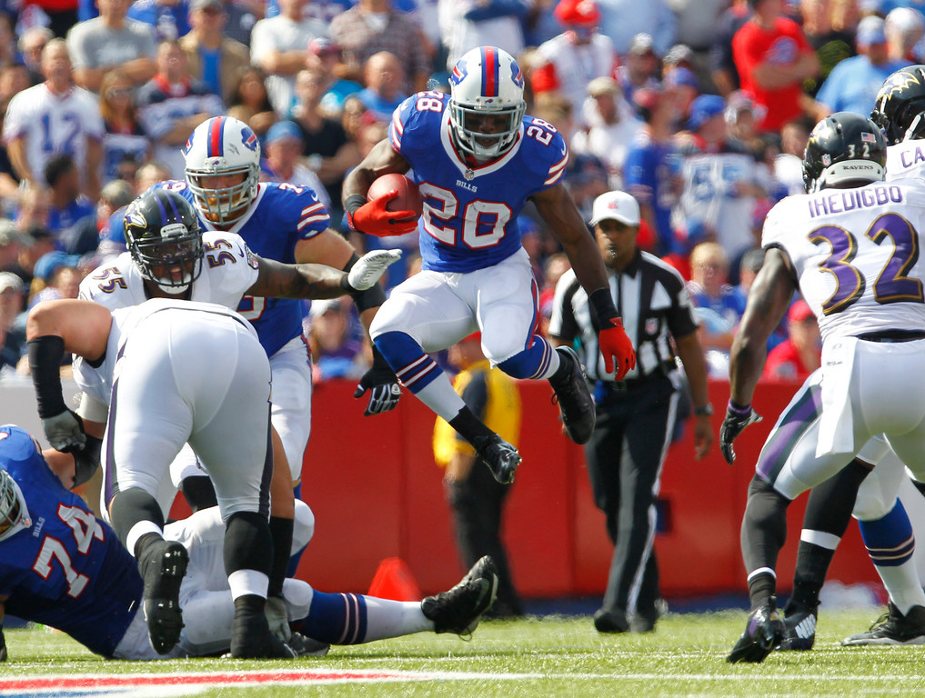 . Buffalo Bills running back C.J. Spiller (28) runs against the Baltimore Ravens during the first half of an NFL football game on Sunday, Sept. 29, 2013, in Orchard Park, N.Y. (AP Photo/Bill Wippert)