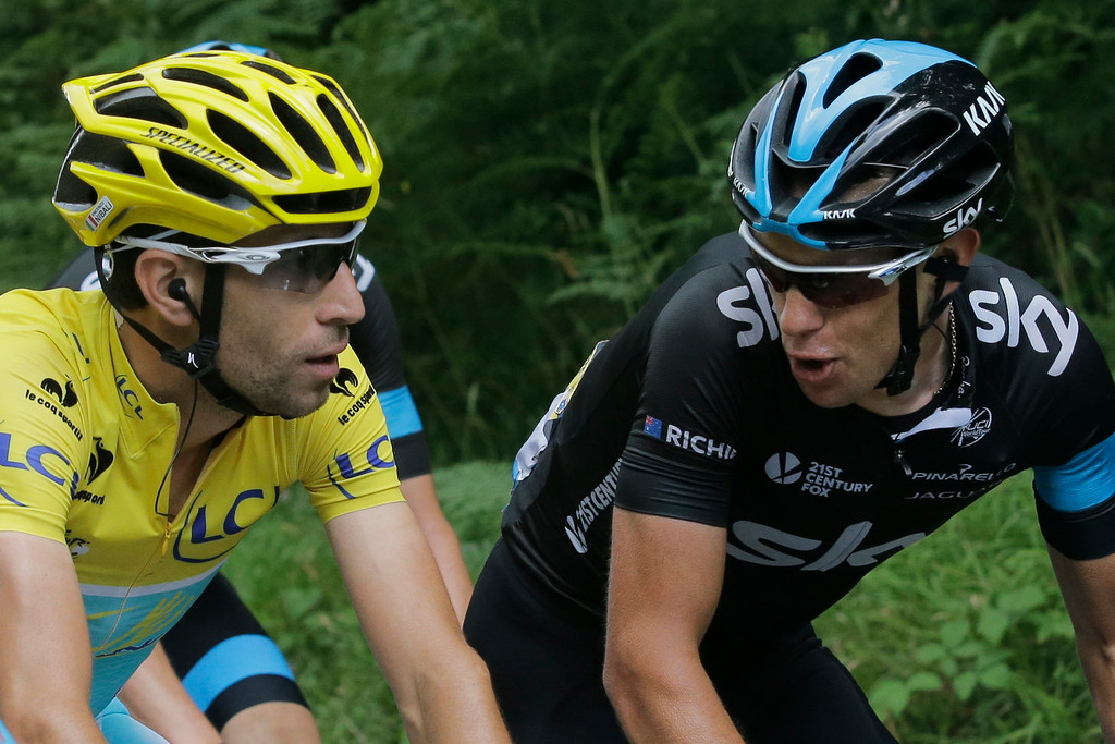 . Italy\'s Vincenzo Nibali, wearing the overall leader\'s yellow jersey, and Australia\'s Richie Porte, right, talk as they ride in the pack during the ninth stage of the Tour de France cycling race over 170 kilometers (105.6 miles) with start in Gerardmer and finish in Mulhouse, France, Sunday, July 13, 2014. (AP Photo/Laurent Cipriani)