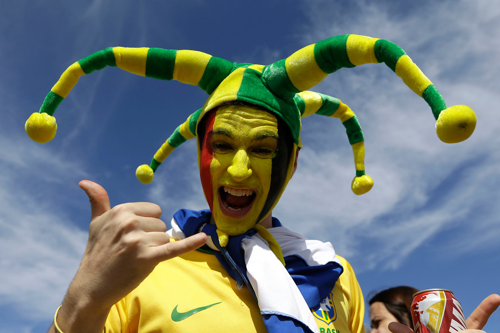 . A Belgium supporter poses for a photo outside the stadium before the group H World Cup soccer match between Belgium and Algeria at the Mineirao Stadium in Belo Horizonte, Brazil, Tuesday, June 17, 2014.  (AP Photo/Sergei Grits)