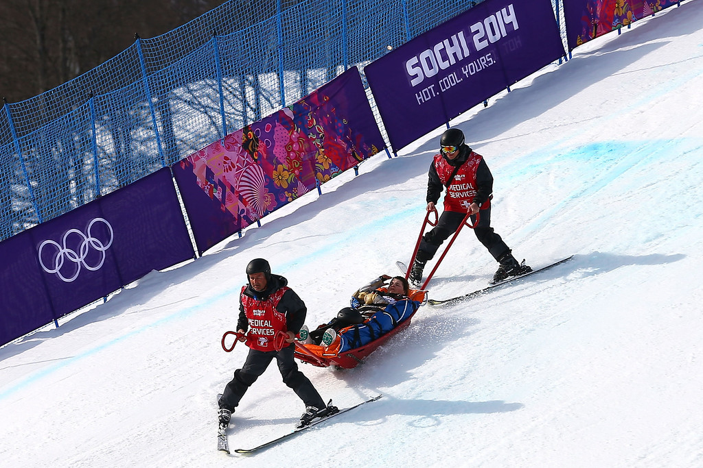 . Jacqueline Hernandez of the United States is stretchered off the course by medics after a fall during the Ladies\' Snowboard Cross Seeding on day nine of the Sochi 2014 Winter Olympics at Rosa Khutor Extreme Park on February 16, 2014 in Sochi, Russia.  (Photo by Streeter Lecka/Getty Images)