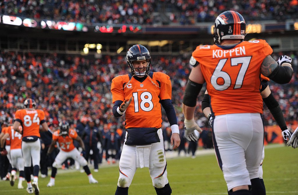 . Denver Broncos quarterback Peyton Manning (18) smiling after Denver Broncos wide receiver Demaryius Thomas (88) touchdown during the third quarter. The Denver Broncos vs Kansas City Chiefs at Sports Authority Field Sunday December 30, 2012. Joe Amon, The Denver Post