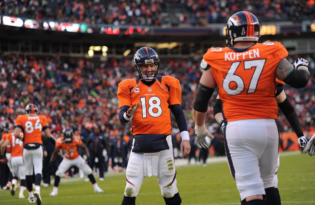 . Denver Broncos quarterback Peyton Manning (18) smiling after Denver Broncos wide receiver Demaryius Thomas (88) touchdown during the third quarter. The Denver Broncos vs Kansas City Chiefs at Sports Authority Field Sunday December 30, 2012. Joe Amon, The Denver Post