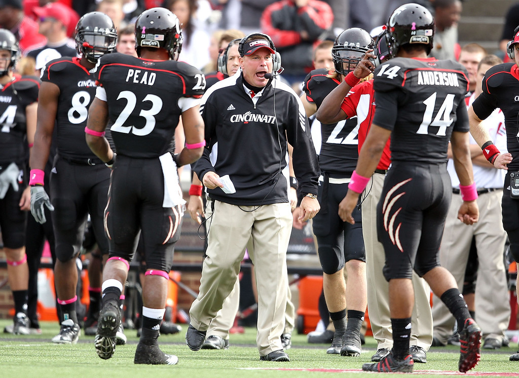 . CINCINNATI - OCTOBER 30:  Butch Jones the Head Coach of the Cincinnati Bearcats gives instructions to his team during the Big East Conference game agains the Syracuse Orange at Nippert Stadium on October 30, 2010 in Cincinnati, Ohio.  (Photo by Andy Lyons/Getty Images) *** Local Caption *** Butch Jones
