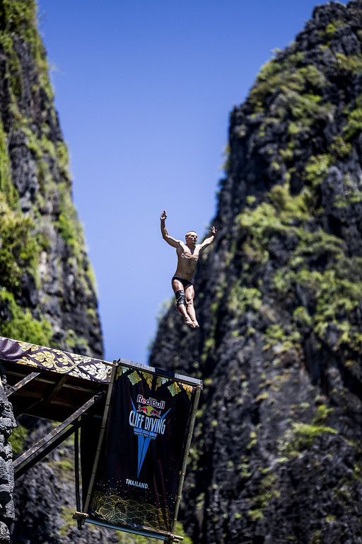 . In this handout image provided by Red Bull, Anatoliy Shabotenko of the Ukraine dives from the 27 meter platform at Maya Bay in the Andaman Sea during the final stop of the 2013 Red Bull Cliff Diving World Series on October 22, 2013 at Phi Phi Island, Thailand. (Photo by Dean Treml/Red Bull via Getty Images)