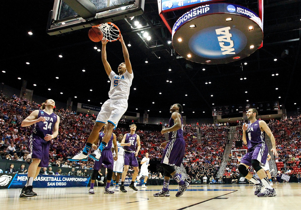 . UCLA guard Kyle Anderson slams home a dunk as UCLA pulls away from Stephen F. Austin during the second half of a third-round game in the NCAA college basketball tournament, Sunday, March 23, 2014, in San Diego. (AP Photo/Gregory Bull)