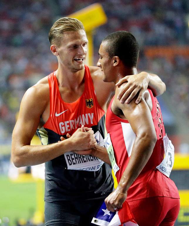. Winner Ashton Eaton of the United States, right, is congratulated by second placed Pascal Behrenbruch following the men\'s 1500-meter decathlon at the World Athletics Championships in the Luzhniki stadium in Moscow, Russia, Sunday, Aug. 11, 2013. (AP Photo/Anja Niedringhaus)