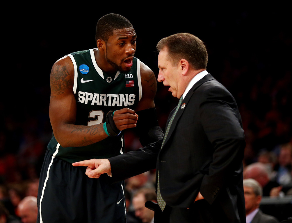 . Head coach Tom Izzo of the Michigan State Spartans talks with Branden Dawson #22 against the Virginia Cavaliers during the regional semifinal of the 2014 NCAA Men\'s Basketball Tournament at Madison Square Garden on March 28, 2014 in New York City.  (Photo by Elsa/Getty Images)