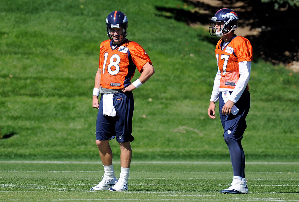 . Quarterback Peyton Manning (18) of the Denver Broncos and quarterback Brock Osweiler (17) of the Denver Broncos look on during drills at practice September 25, 2013 at Dove Valley. (Photo by John Leyba/The Denver Post)
