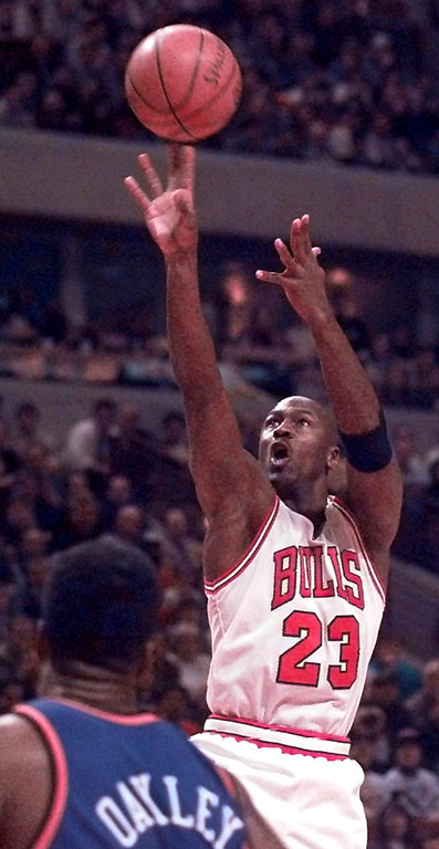 . Chicago Bulls\' Michael Jordan shoots over New York Knicks\' Charles Oakley during the Bulls 88-87 victory in this Jan. 21, 1997 photo, in Chicago. There was another sign Saturday, Sept. 22, 2001, that Jordan\'s return is imminent. A column in The Washington Post, without citing sources, said Jordan would confirm ``early next week, probably Monday\'\' his decision to play for the Washington Wizards this season.  (AP Photo/Michael S. Green)