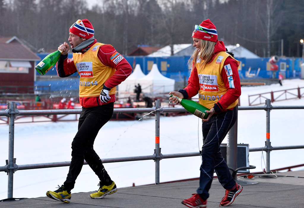 . Norway\'s Therese Johaug (R) and compatriot Martin Johnsrud Sundby celebrate winning both the cross-country skiing overall World Cup and the cross-country skiing distance cup at the FIS Cross Country World Cup in Falun, Sweden, 16 March 2014.  EPA/ANDERS WIKLUND