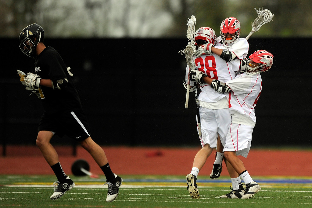 . DENVER, CO - MAY 15: Players from Regis Jesuit High School celebrate after a goal during the first quarter against Arapahoe during a CHSAA 5A boys lacrosse semifinal game on May 15, 2013, in Denver, Colorado. Arapahoe won 13-5 to advance to the finals. (Photo by Daniel Petty/The Denver Post)