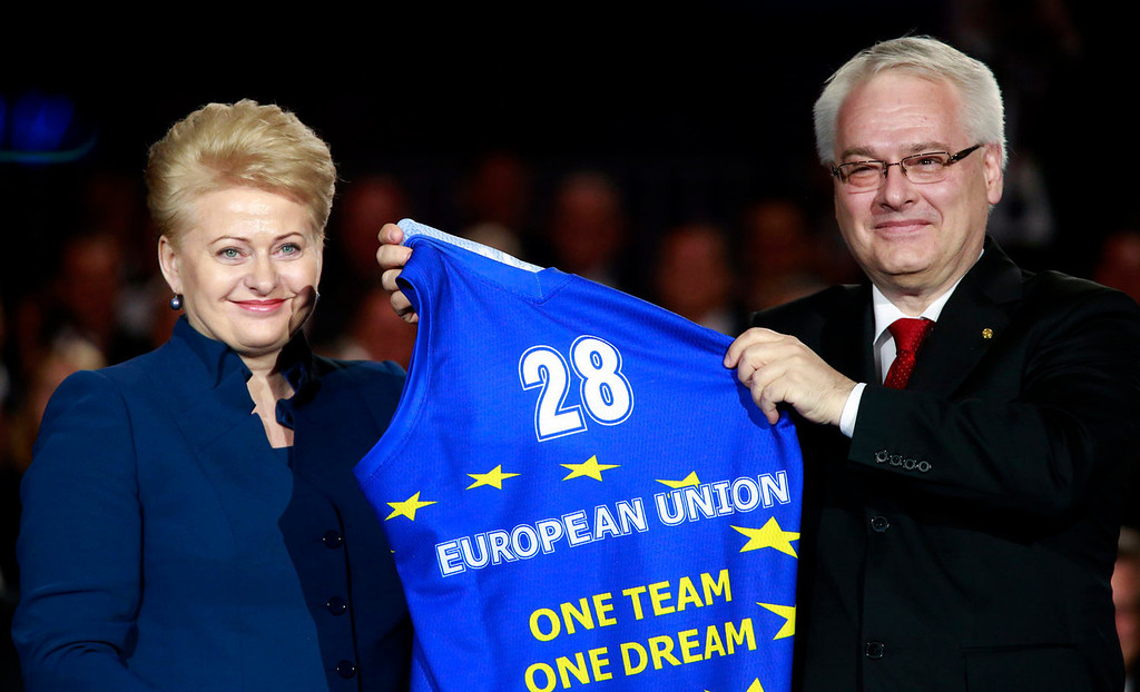 . Croatia\'s President Ivo Josipovic, right, receives a shirt from Lithuania\'s President Dalia Grybauskaite as they celebrate Croatia\'s entry into the European Union, on the central square in Zagreb, Croatia, Sunday, June 30, 2013.  Fireworks lit the sky and festive crowds gathered on the streets to mark Croatia\'s entry Monday into the European Union, a major milestone some 20 years after the country won independence in a bloody civil war that shook the continent.  (AP Photo/Darko Bandic)