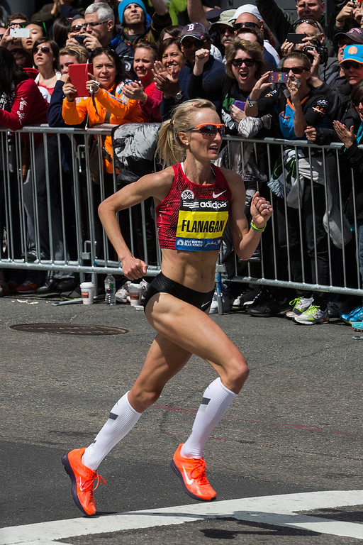 . Shalane Flanagan runs in the Boston Marathon on April 21, 2014 in Boston, Massachusetts. Today marks the 118th Boston Marathon; security presence has been increased this year, due to two bombs that were detonated at the finish line last year, killing three people and injuring more than 260 others.  (Photo by Andrew Burton/Getty Images)