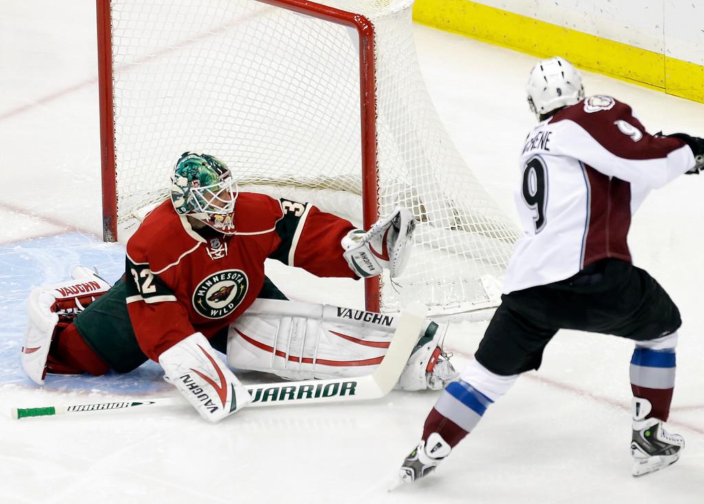 . Minnesota Wild goale Niklas Backstrom, left, of Finland, gloves a shot by Colorado Avalanche\'s Matt Duchene in the first period of an NHL hockey game on Thursday, Feb. 14, 2013 in St. Paul, Minn. (AP Photo/Jim Mone)