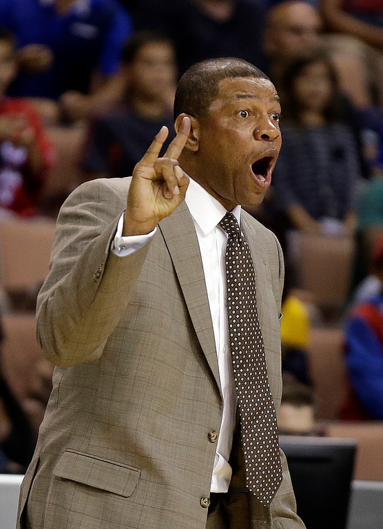 . The Los Angeles Clippers head coach Doc Rivers instructs his team during the second half of a preseason NBA basketball game against the Denver Nuggets on Saturday, Oct. 19, 2013, in Las Vegas. The Clippers defeated the Nuggets in overtime 118-111. (AP Photo/Isaac Brekken)