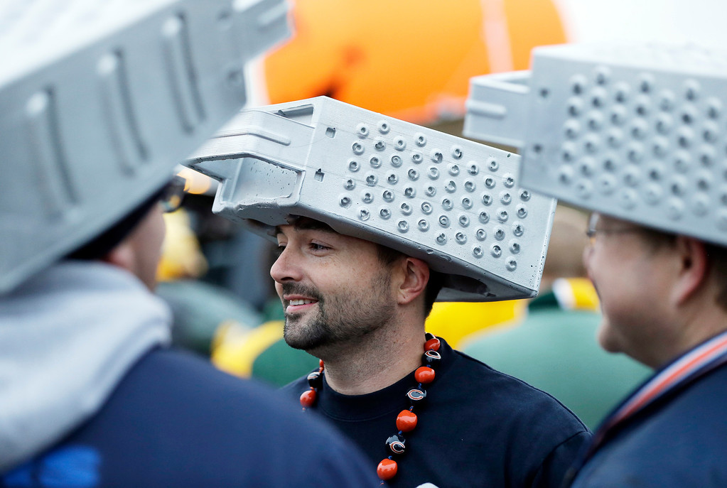 . Chicago Bears fan Dean Donlon wears a cheese grater hat before NFL football game against the Green Bay Packers Monday, Nov. 4, 2013, in Green Bay, Wis. (AP Photo/Mike Roemer)