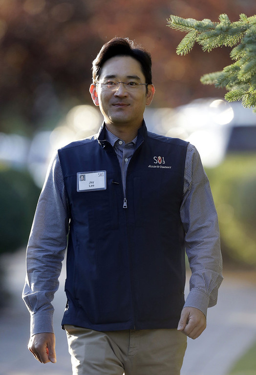 . Jay Lee, of Samsung Electronics Co., Ltd. walks to the morning session at the Allen & Company Sun Valley Conference in Sun Valley, Idaho, Wednesday, July 10, 2013. (AP Photo/Rick Bowmer)