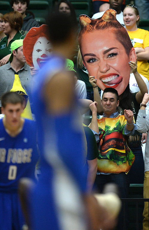 . FORT COLLINS, CO. - JANUARY 18:  Rams fans tried to distract the Falcons with cutouts of Ronald McDonald and Miley Cyrus. The Colorado State men\'s basketball team defeated Air Force 74-68 at Moby Arena in Fort Collins Saturday night, January 18, 2014. Photo By Karl Gehring/The Denver Post
