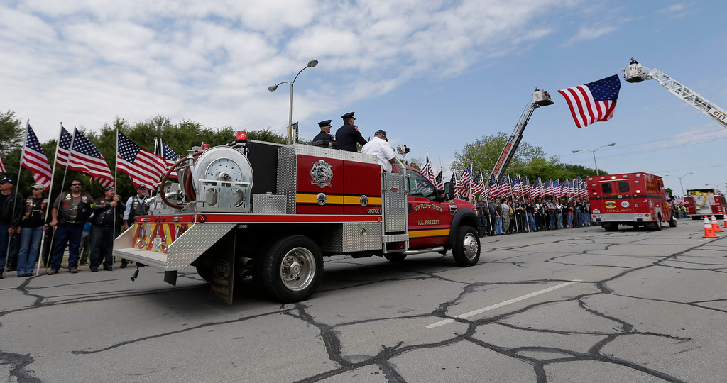 . Fire trucks take part in a procession prior to a memorial service for first responders who died in last week\'s fertilizer plant explosion in West, Texas, Thursday, April 25, 2013, in Waco, Texas. (AP Photo/Eric Gay)
