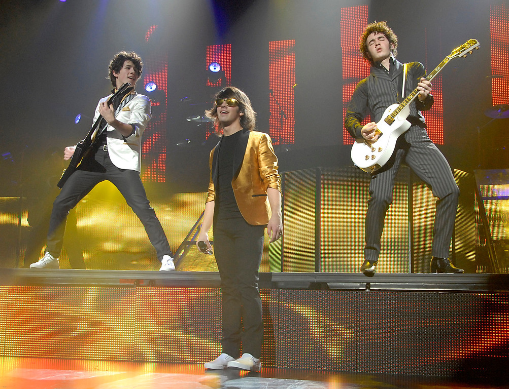 . From left to right, Kevin Jonas, Joe Jonas, and Nick Jonas of the band Jonas Brothers perform at the Gibson Amphitheatre in Universal City, Calif. on Sunday, February 3, 2008. (AP Photo/Dan Steinberg)