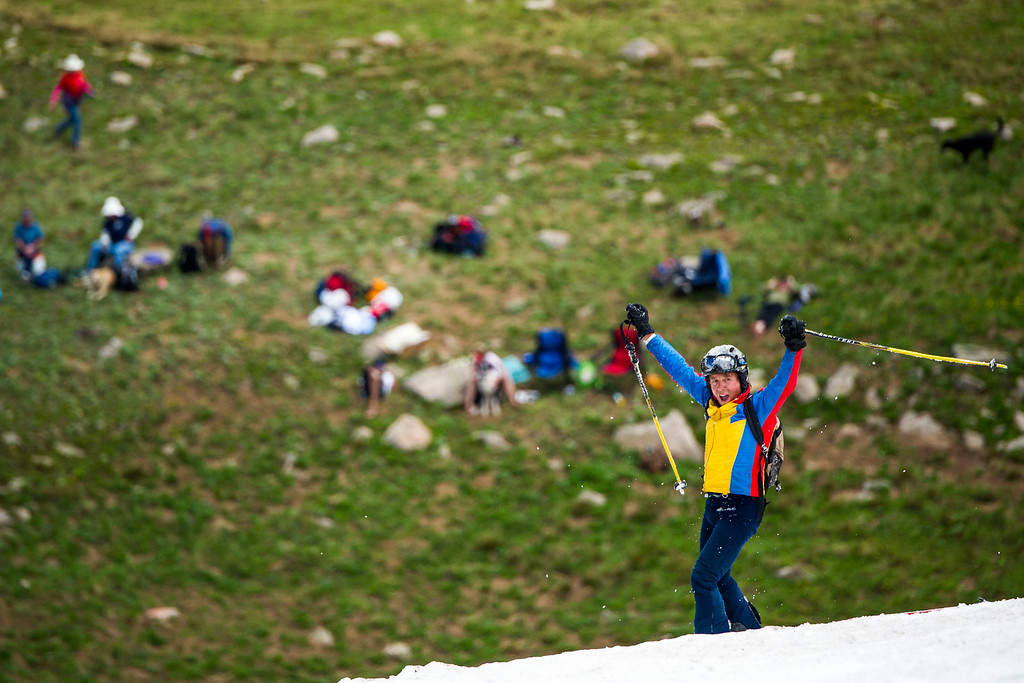 . Glen Johnson, of Dillon celebrates after wiping out on a run during the 49th running of the Epworth Cup, an unofficial ski race atop Corona Pass on Sunday, July 13, 2014 in Winter Park, CO.  The summer ski race, which was originally founded in 1966 is a memorial to a Winter Park patroller that died on Mt. Epworth.  (Photo by Kent Nishimura/The Denver Post)