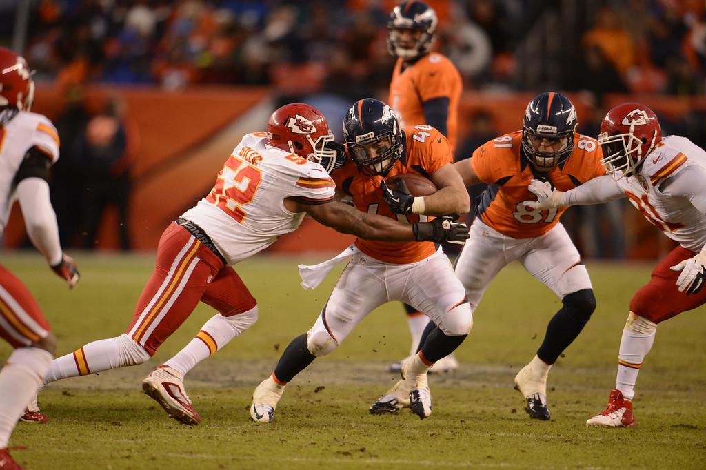 . Denver Broncos quarterback Brock Osweiler (6) hands off to Denver Broncos running back Jacob Hester (40) in the fourth quarter as the Denver Broncos took on the Kansas City Chiefs at Sports Authority Field at Mile High in Denver, Colorado on December 30, 2012. John Leyba, The Denver Post