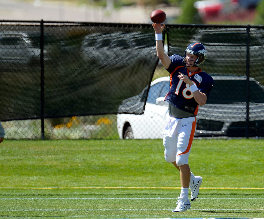 . Denver Broncos QB Peyton Manning (18) throws a pass in drills during training camp August 5, 2013 at Dove Valley. (Photo By John Leyba/The Denver Post)